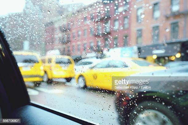 Waterdrops On Glass With View Of Cars On Road