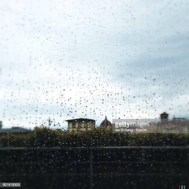 Waterdrops on glass with view of houses