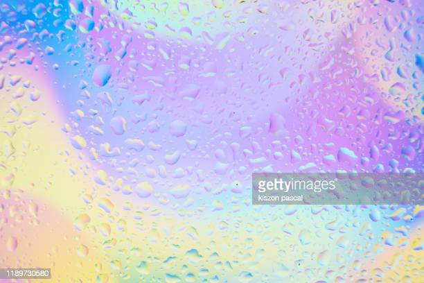 waterdrops on window glass with colourful background . - humid stock pictures, royalty-free photos & images