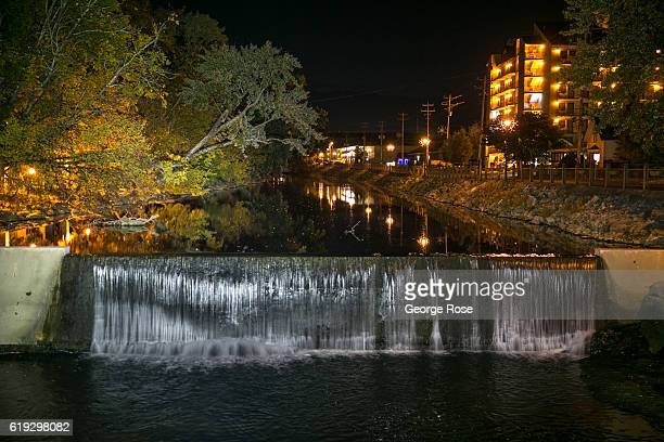 Waterfall along the Little Pigeon River near The Old Mill is viewed on October 18, 2016 in Pigeon Forge, Tennessee. Located near the entrance to...