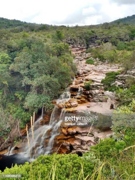 waterfall and a river - poço do diabo - chapada diamantina national park - bahia, brazil - parco nazionale di chapada diamantina foto e immagini stock