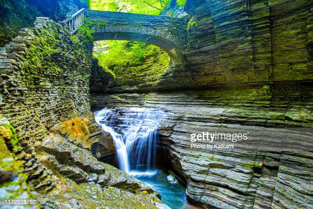waterfall and bridge at watkins glen state park, new york - finger lakes stock pictures, royalty-free photos & images
