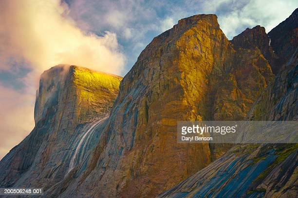 waterfall and cliffs, clyde inlet, baffin island, nunavut, canada - baffin island stock pictures, royalty-free photos & images