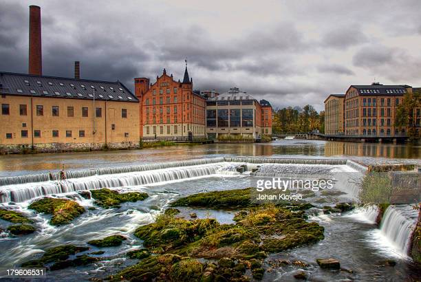 waterfall and houses in norrköping's industry area - norrkoping fotografías e imágenes de stock