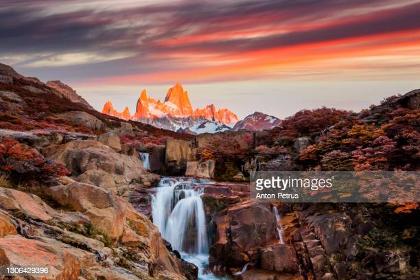 waterfall and mount fitz roy at sunset. patagonia, argentina - argentina stock pictures, royalty-free photos & images