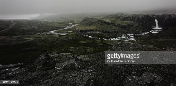 Waterfall and river in rocky landscape