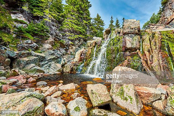 waterfall at black brook cove beach, nova scotia - cape breton island stock pictures, royalty-free photos & images