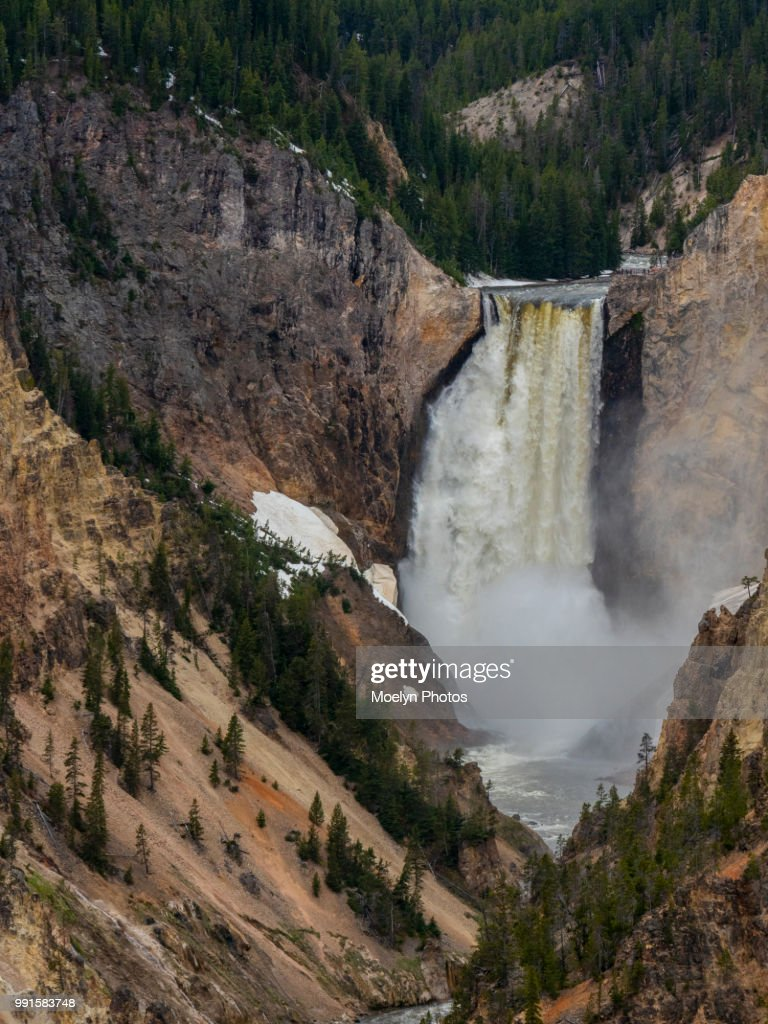 Waterfall At Grand Canyon Of The Yellowstone River Tourists