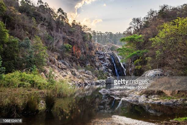 waterfall at sunset - swaziland stock pictures, royalty-free photos & images