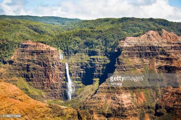 waterfall at the waimea canyon in kauai, hawaii - water fall hawaii stock pictures, royalty-free photos & images