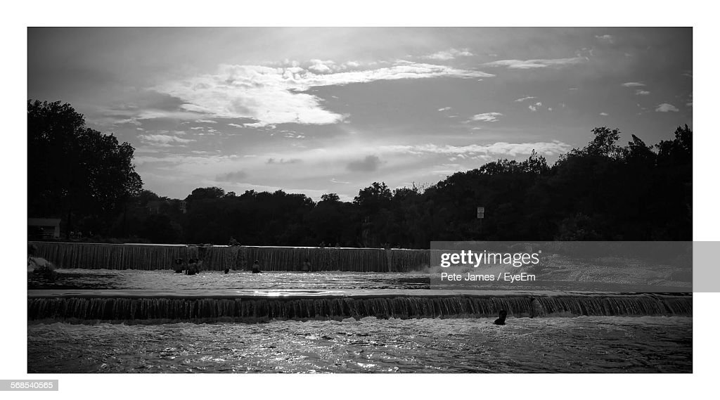 Waterfall By Silhouette Trees In Blue Hole Park : Stock Photo