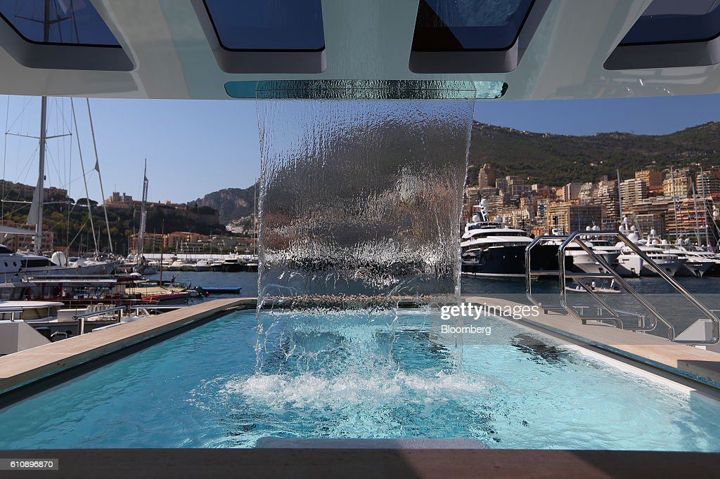 A waterfall cascades into the infinity pool on-board the