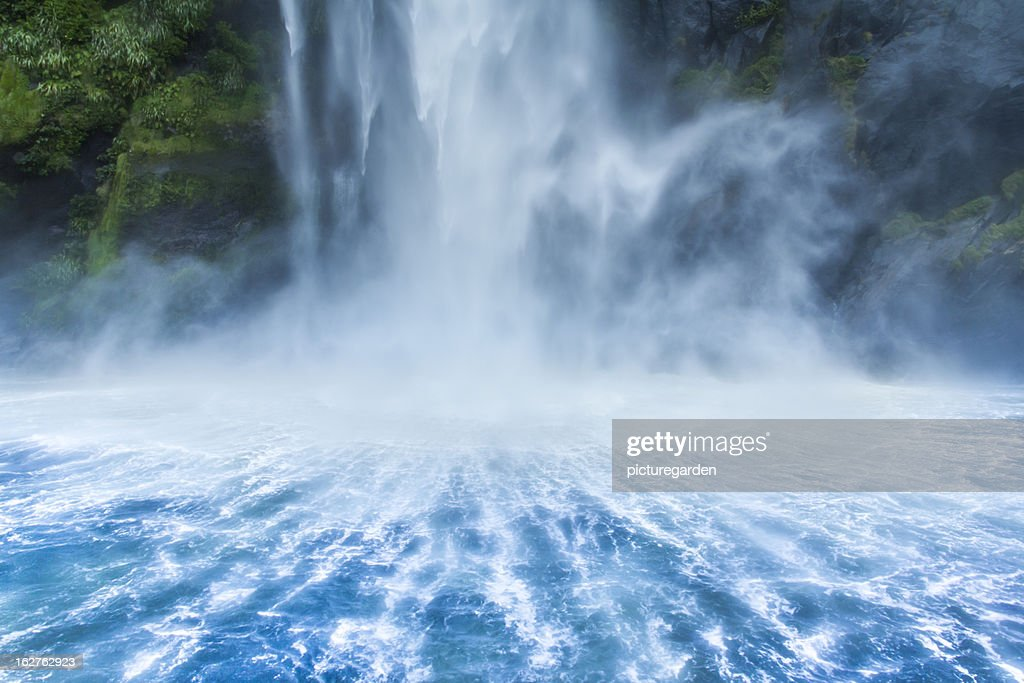 Waterfall Dropping into Fjord : Stock Photo