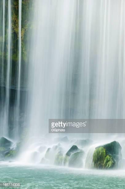 Waterfall falling on moss covered rocks