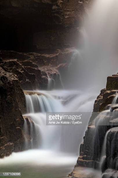 waterfall in a gorge, rondane mountain area, norway. - arne jw kolstø stock pictures, royalty-free photos & images