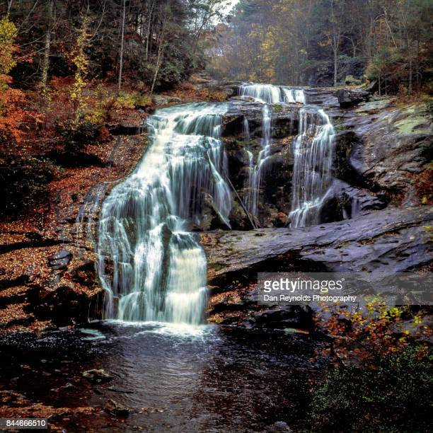 Waterfall in autumn with colorful foliage