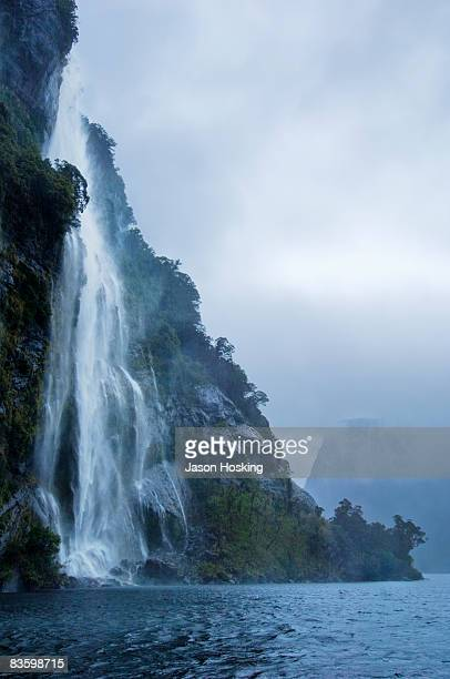 Waterfall in Fiordland National Park, New Zealand