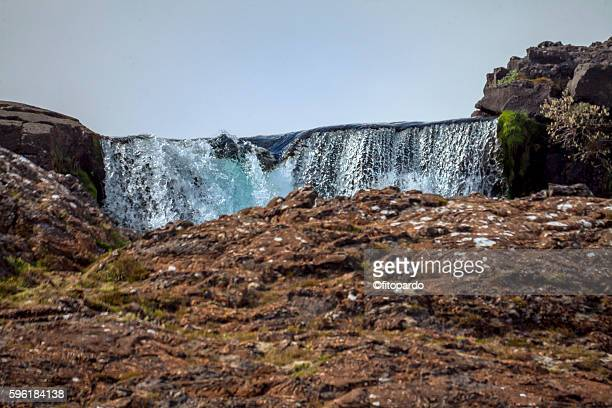 waterfall in þingvellir national park, iceland - plate tectonics stock photos and pictures
