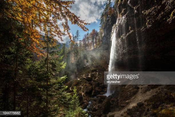 waterfall in the mountain of slovenia during autumn season. - paesaggio spettacolare foto e immagini stock