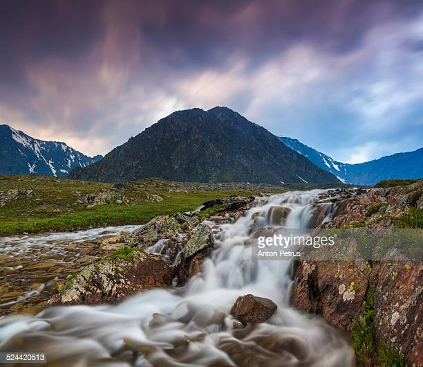 Waterfall in the mountains at sunset