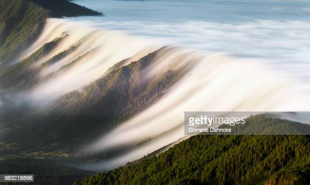 waterfall of clouds (la palma island. canary islands) - wind stock pictures, royalty-free photos & images