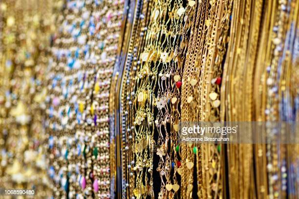 waterfall of gold chains - gold chain stock photos and pictures