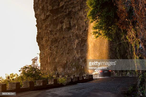 waterfall on road lit by sunset light - merten snijders 個照片及圖片檔