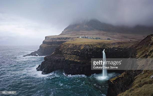 Waterfall on rocky coastline