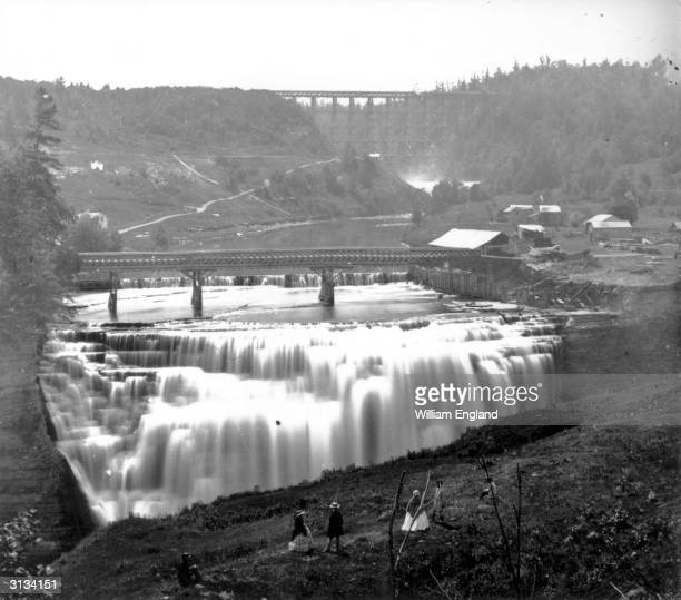 A waterfall on the Genesee River in Rochester New York State The High Bridge can be seen in the background