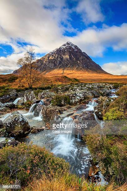Waterfall on the River Coupall with Buachaillie Etive Mor in the distance.