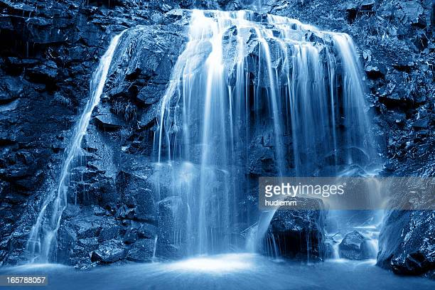 waterfall - spring flowing water stock pictures, royalty-free photos & images