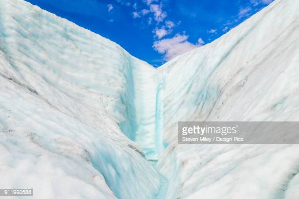 A waterfall pours down the ice of Root Glacier in Wrangell-St. Elias National Park