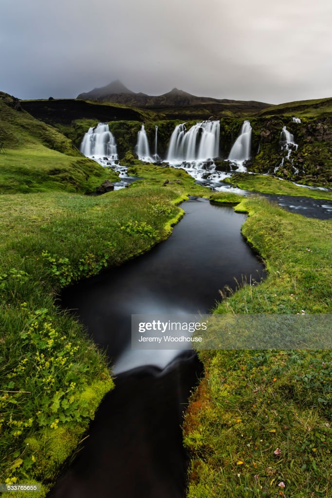 Waterfall, river and rock formations in remote landscape : Foto stock