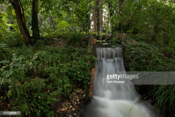 Waterfall running into the river Wandle on August 24, 2020 in London, England. The river Wandle is a tributary of the river Thames running north for...