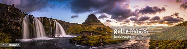Waterfall sunrise idyllic mountain stream through panoramic peaks Kirkjufell Iceland