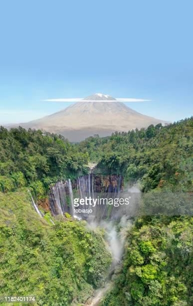 waterfall, volcano and tropical rainforest in indonesia - java stock pictures, royalty-free photos & images