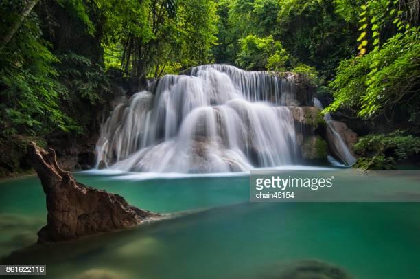 Waterfall with deep forrest waterfall in Erawan waterfall National Park Kanjanaburi Thailand.