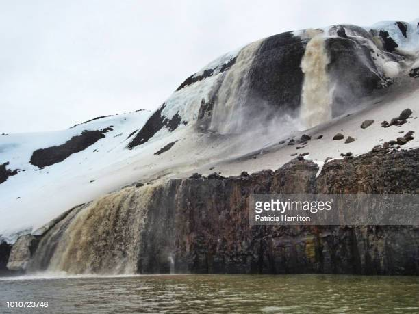 Waterfall with sediment colouring it brown
