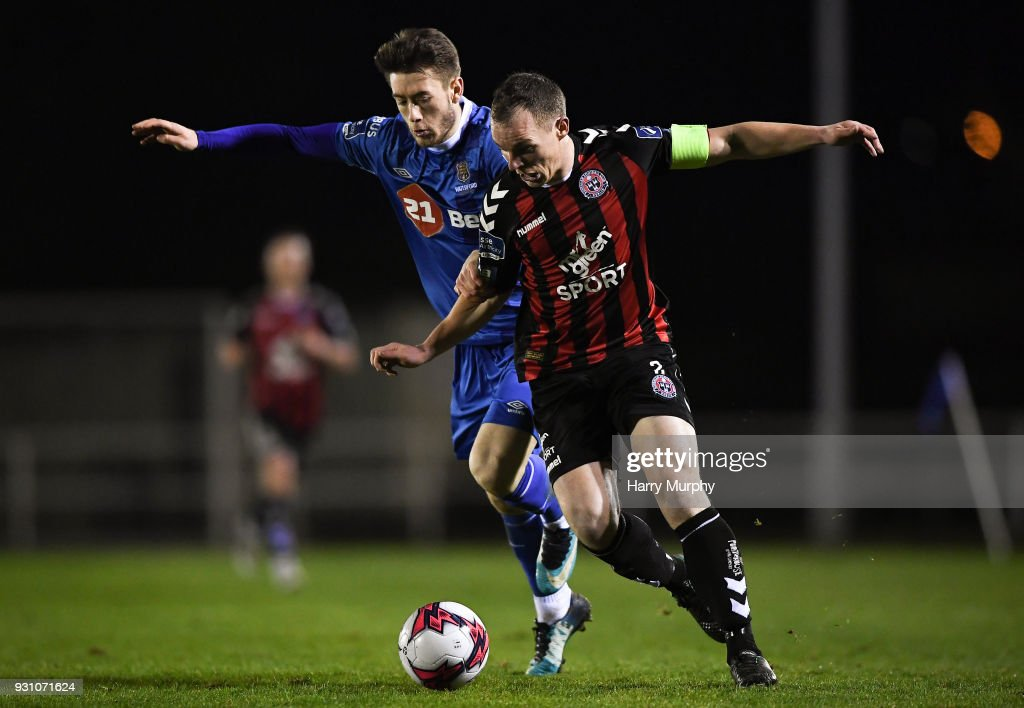 Waterford , Ireland - 12 March 2018; Derek Pender of Bohemians in action against Derek Daly of Waterford during the SSE Airtricity League Premier Division match between Waterford and Bohemians at Waterford Regional Sports Centre in Waterford.
