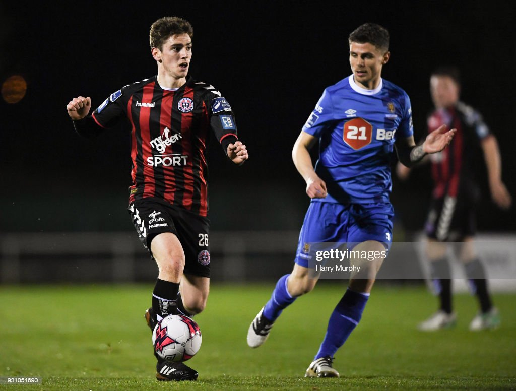 Waterford , Ireland - 12 march 2018; Dylan Watts of Bohemians in action against Gavan Holohan of Waterford during the SSE Airtricity League Premier Division match between Waterford and Bohemians at Waterford Regional Sports Centre in Waterford.