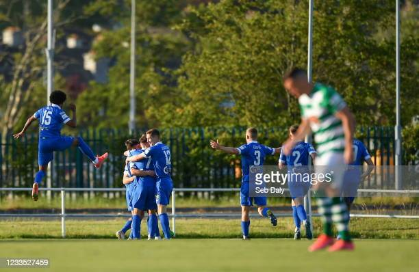 Waterford , Ireland - 18 June 2021; Eric Molloy of Waterford, hidden, celebrates with team-mates after scoring his side's first goal during the SSE...