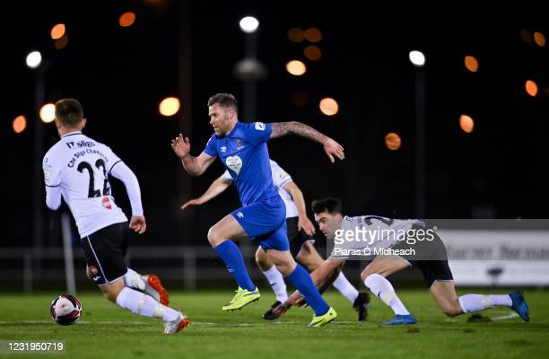 Waterford , Ireland - 26 March 2021; Daryl Murphy of Waterford gets past John Mahon, right, and David Cawley of Sligo Rovers during the SSE...
