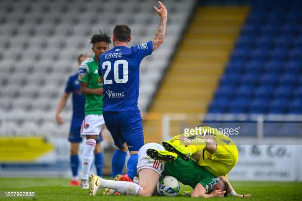 Waterford , Ireland - 8 August 2020; Kurtis Byrne of Waterford appeals for handball as Kevin O'Connor and Mark McNulty of Cork City collide during...