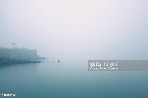 Waterfront and river in mist, Red Hook, Brooklyn, New York, USA
