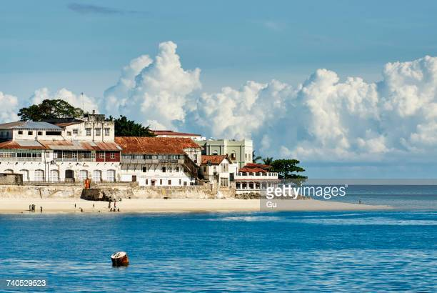 waterfront building on beach, zanzibar city, zanzibar urban, tanzania, africa - zanzibar island stock photos and pictures