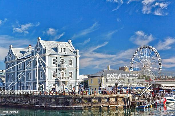 waterfront buildings and wheel - uferviertel stock-fotos und bilder