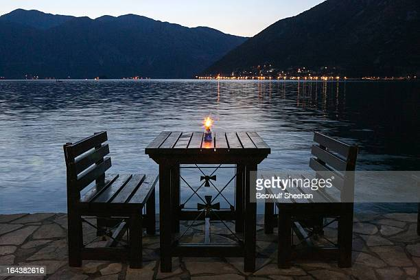 Waterfront chairs and dining table with oil candle