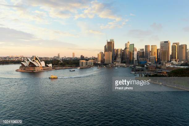 waterfront city skyline of sydney city downtown during sunset with modern architectural landmarks in sydney, australia. - opera house stock pictures, royalty-free photos & images