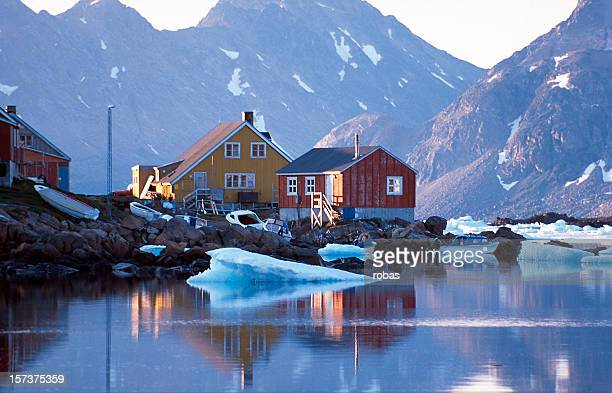 waterfront homes in greenland with mountains in background - greenland stock pictures, royalty-free photos & images
