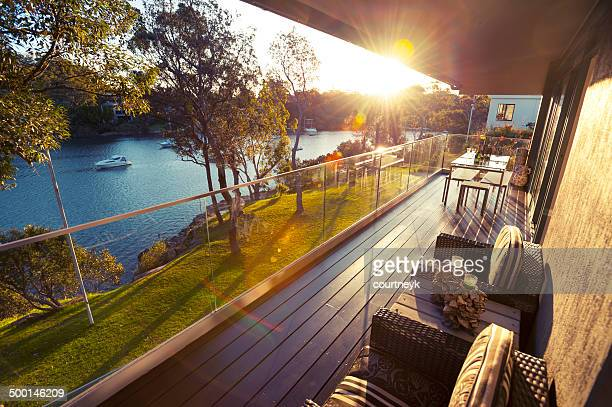 waterfront house balcony - deck stock pictures, royalty-free photos & images